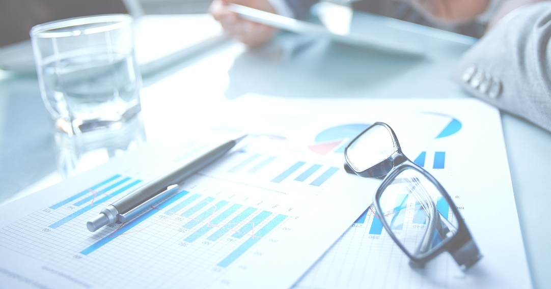 bigstock-Image-of-eyeglasses-and-financ-60459065lighter1